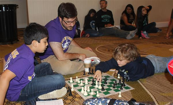 Two T.S. Cooley Chess Members Compete At National Chess Championship