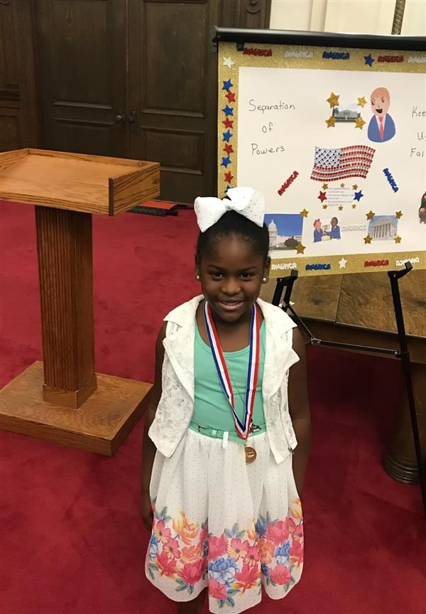 1st Grader Wins 1st Place in Law Day Poster Contest